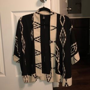 Black and Cream throw over W/ triangle patterns
